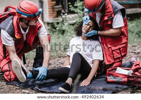 Disaster relief, rescue team helping injured victim #492402634