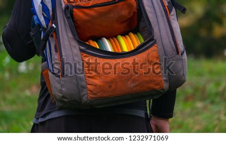 Disc golf bag on the back