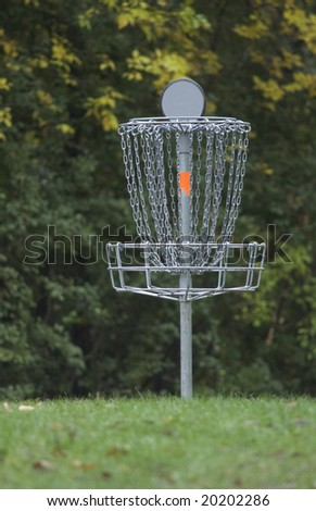 Disc golf basket or pole hole surrounded by trees