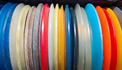 Disc golf discs in many colors