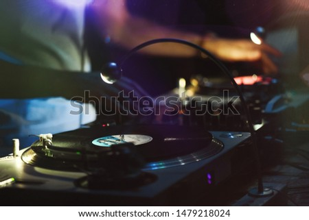 Disc jockey in action during 80's vintage party