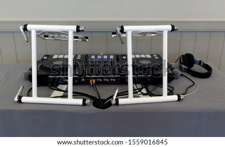 Disc jockey's audio equipment set up on table.