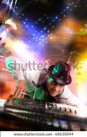 Disc jockey work with electronic mixer and mixing records at night club