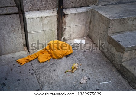 Discarded items lying on the sidewalk #1389975029