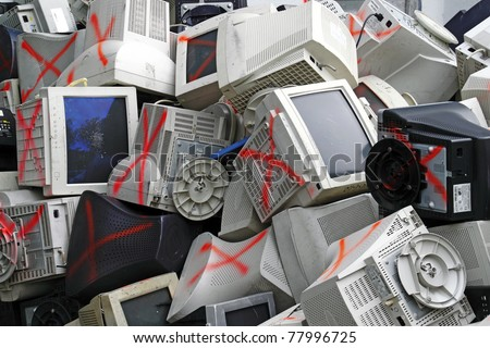 Discarded obsolete computer monitor and equipment being processed for recycle.