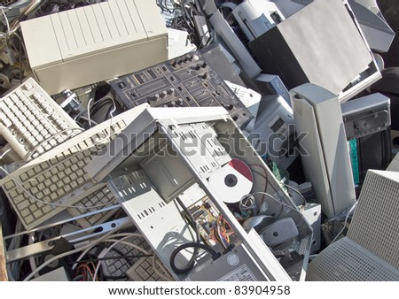 Discarded obsolete electronic equipment / computer scrap - stock photo