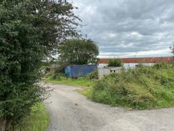 Discarded shipping containers, and old outbuildings on, Healey Croft Lane, East Ardsley, Wakefield, UK