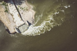 Discharge of sewage into the river, ecological disaster after failure of the sewage treatment plant, Warsaw, Poland