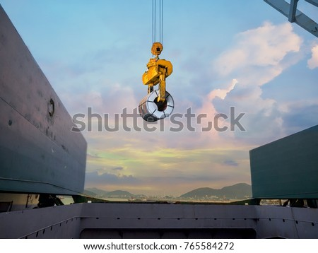 Discharging steel coil from vessel's hold to terminal warehouse.