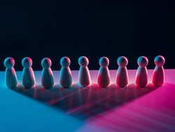 Discipline among company employees. Concept - organization of discipline of  company personnel. Labor discipline personnel. Figures of people are standing nearby. They are illuminated with neon light