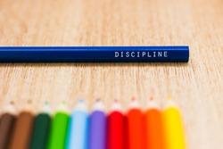 Discipline word written on a colored pencil. Education, school, discipline concepts