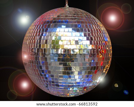 Disco ball with sparkles isolated in black
