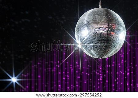 Disco ball with stars in nightclub with striped violet and black walls lit by spotlight
