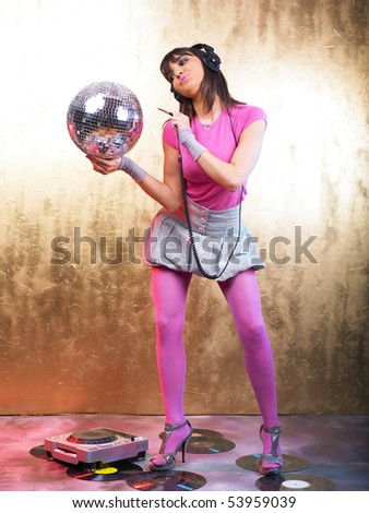 Disco Girls with Glitter Ball and Headphones In Night Club