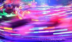 disco lights synth wave retro neon lights fairground ride night lights funfair pink purple proton light trails,  long exposure illuminations futuristic sci fi synthwave vapor stock photo photograph