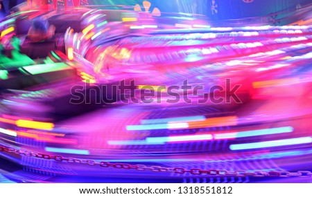 disco lights synth wave retro neon lights fairground ride night lights funfair pink purple proton light trails,  long exposure illuminations futuristic sci fi synthwave vapor stock photo photograph