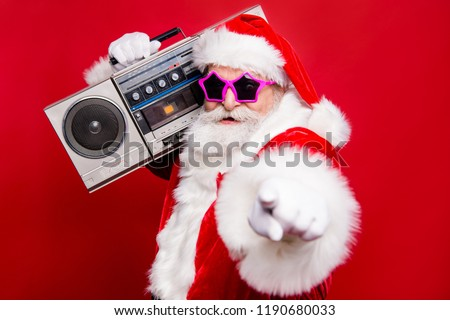 Disco trendy noel christmastime eve winter wish December stylish funky aged mature star Santa tradition costume white beard vintage record indicate show point fingers isolated red background #1190680033