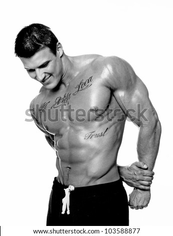 Discolored image of muscle man posing in studio