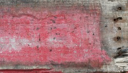Discoloured scratched rustic faded red wood plank texture