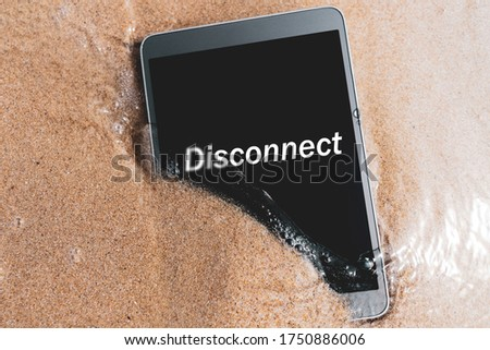 Disconnect words on smart phone at tropical sand beach texture background. Technology business and travel nature concept.  Photo stock ©