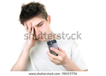 discontented young man looking on the mobile phone. isolated on the white