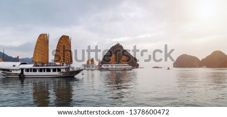 Discover Halong Bay Top Destinations Ha Long Bay is a UNESCO World Heritage Site, and a popular travel destination. Tourist boat high cliff.