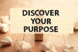 Discover your purpose, text words typography written on paper against wooden background, life and business motivational inspirational concept