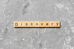 discovery word written on wood block. discovery text on table, concept.