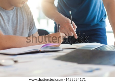 Discussions and work plans. New young businessmen discuss strategies and plan to start a business. University students discuss academic projects with notes. #1428254171