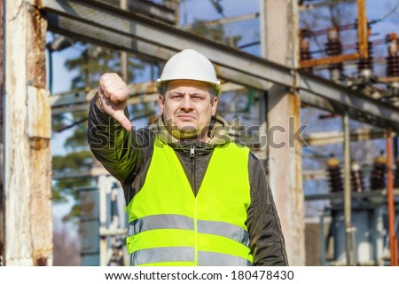 Disgruntled Electrical Engineer in an electric substation.