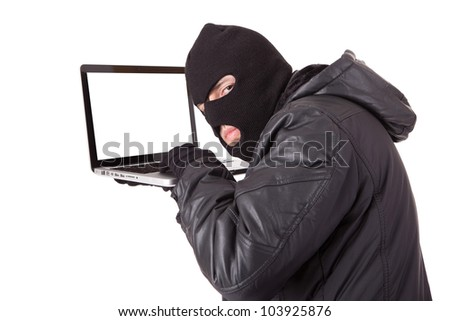 Disguised computer hacker with laptop