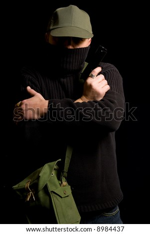 Disguised gunman crossing his arms