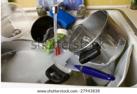 disgusting dirty sink full with dirty dishes