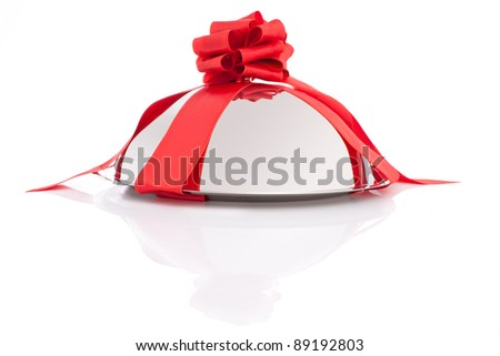 Dish dome with red ribbon as a gift isolated on white background