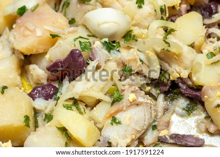 dish known as codfish food, containing codfish, onion, egg, potato and black olives, very popular in Brazil. Stock photo ©