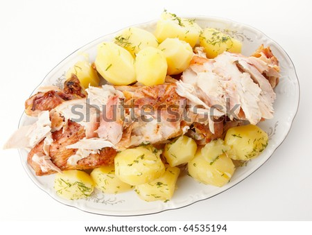 Dish of boiled potatos and sliced turkey