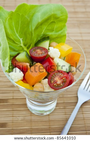 Dish of colorful vegetable and chickpea salad - stock photo