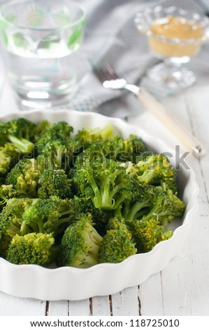 Dish of cooked broccoli, selective focus