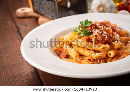 Dish of delicious italian penne pasta with bolognese ragu sauce, Italian Cuisine  ストックフォト ©