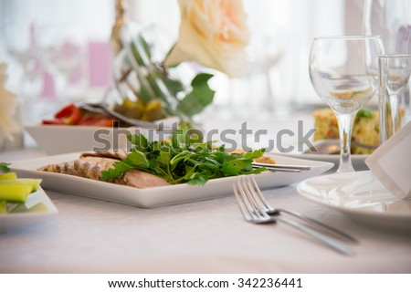 Dish of food. Cold snacks. Serving of food. Table decorations. Menu for a person. Food for anniversaries, weddings and celebrations.