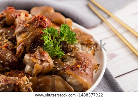 Dish of gourmet dish sauce marinated trotters closeup on wooden background #1488577922