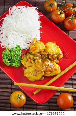 dish of meat in the sauce and rice noodles #179359772