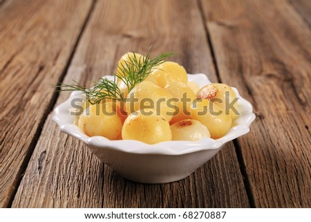 Dish of small potato balls fried in butter