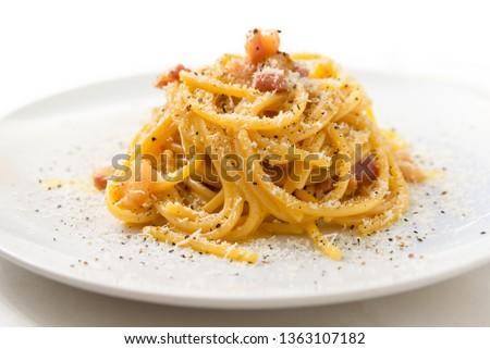 Dish of Spaghetti alla Carbonara, typical italian recipe of pasta with guanciale, egg ad pecorino romano cheese