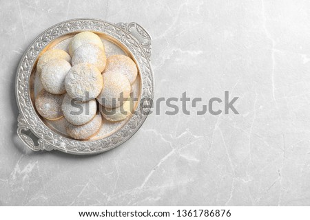 Dish of traditional cookies for Islamic holidays on table, top view with space for text. Eid Mubarak