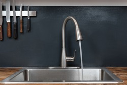 Dish sink with running water in a chef's kitchen