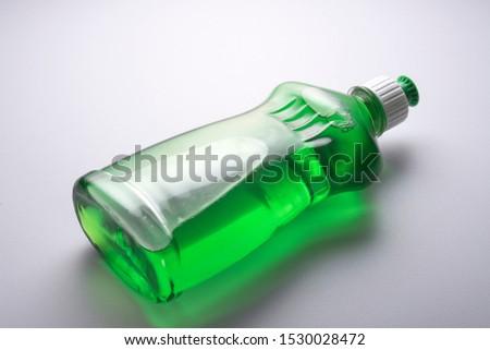 Dish wash detergent liquid soap container on white background.