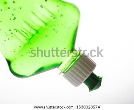 Dish wash detergent liquid soap on white background.