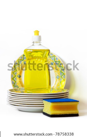dish washing gear and a pile of dishes over white background