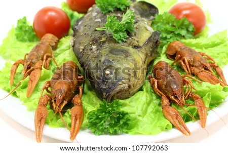 dish with crayfish smoked fish,salad and tomato - stock photo